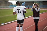 Home defender Joe Mbu posing for a family photograph after the final whistle in the Scottish pyramid play-off second leg between Edinburgh City (in white) and Cove Rangers at the Commonwealth Stadium at Meadowbank in Edinburgh. The match between the champions of the Lowland and Highland Leagues determined which club would play-off against East Stirlingshire for a place in the Scottish league. The second leg ended 1-1, giving Edinburgh City a 4-1 aggregate win.