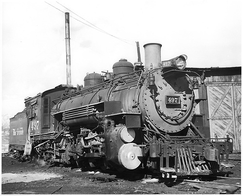 D&amp;RGW #497 K-37 beside Durango roundhouse.<br /> D&amp;RGW  Durango, CO  Taken by Payne, Andy M. - 1/26/1960