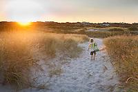 Child walking on a sandy trail, Barnegat, New Jersey