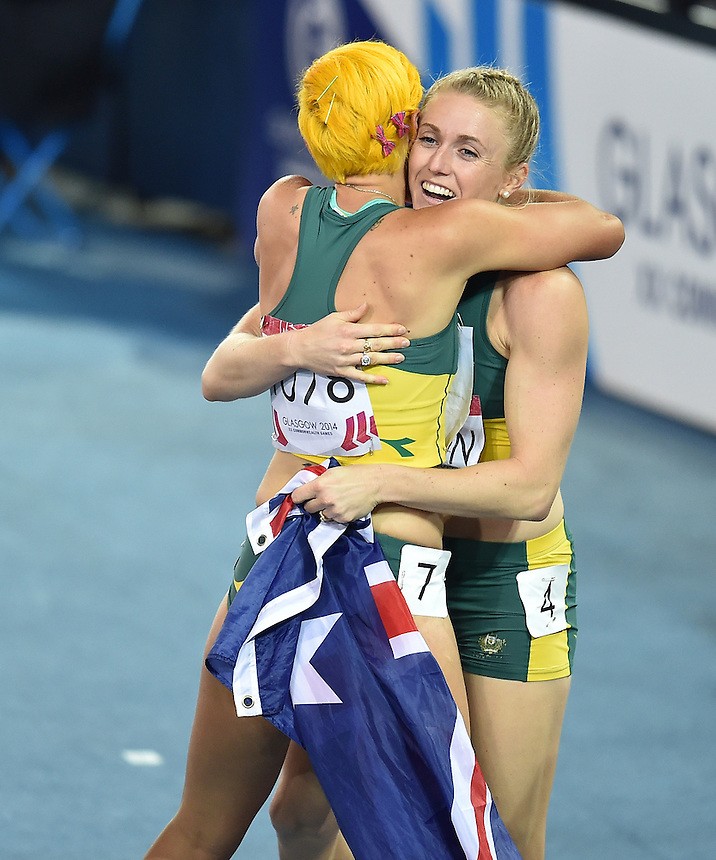 Australia's Sally Pearson, right, celebrates winning gold in the women's 100m hurdles with Australia's Shannon McCann<br /> <br /> Photographer Chris Vaughan/CameraSport<br /> <br /> 20th Commonwealth Games - Day 9 - Friday 1st August 2014 - Athletics - Hampden Park - Glasgow - UK<br /> <br /> &copy; CameraSport - 43 Linden Ave. Countesthorpe. Leicester. England. LE8 5PG - Tel: +44 (0) 116 277 4147 - admin@camerasport.com - www.camerasport.com