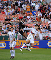 DC United forward Luciano Emilio (11) tangles with Real Salt Lake defender Tony Beltran (2) in the air, fighting for the ball.  DC United tied Real Salt Lake 0-0 at  RFK Stadium, Saturday May 23, 2009.