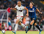 Alex Rodrigo Dias Da Costa of AC Milan (L) competes for the ball with  Samuele Longo of FC Internazionale Milano (R) during the AC Milan vs FC Internacionale as part of the International Champions Cup 2015 at the looks onnggang Stadium on July 25, 2015 in Shenzhen, China.  Photo by Aitor Alcalde / Power Sport Images