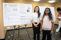 "Ashley Lam and Sherin Aboobucker present ""Synthesis of Polymetallocenes for Redox Flow Batteries""<br /> Mentor: Michael Hill, Chemistry<br /> Occidental College's Undergraduate Research Center hosts their annual Summer Undergraduate Research Conference on July 31, 2019. Student researchers presented their work as either oral or poster presentations at this final conference. The program lasts 10 weeks and involves independent research in all departments.<br /> (Photo by Marc Campos, Occidental College Photographer)"