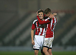 Regan Slater of Sheffield Utd is hugged by David Brooks of Sheffield Utd during the Checkatrade Trophy match at Blundell Park Stadium, Grimsby. Picture date: November 9th, 2016. Pic Simon Bellis/Sportimage