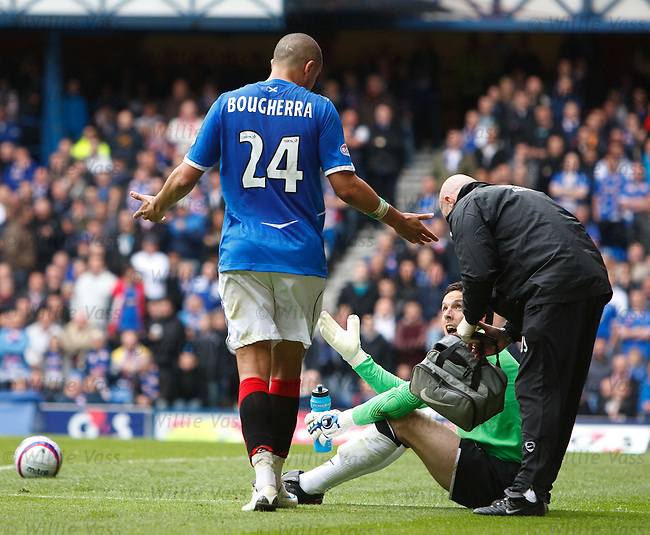 Madjid Bougherra walks off the field and appeals to grounded keeper Jamie Langfield