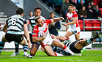 Picture by Alex Whitehead/SWpix.com - 01/05/2014 - Rugby League - First Utility Super League - St Helens v London Broncos - Langtree Park, St Helens, England - St Helens' Lance Hohaia is tackled by London's defence.