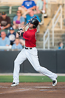Louie Lechich (21) of the Kannapolis Intimidators follows through on his swing against the Delmarva Shorebirds at CMC-Northeast Stadium on June 6, 2015 in Kannapolis, North Carolina.  The Shorebirds defeated the Intimidators 7-2.  (Brian Westerholt/Four Seam Images)