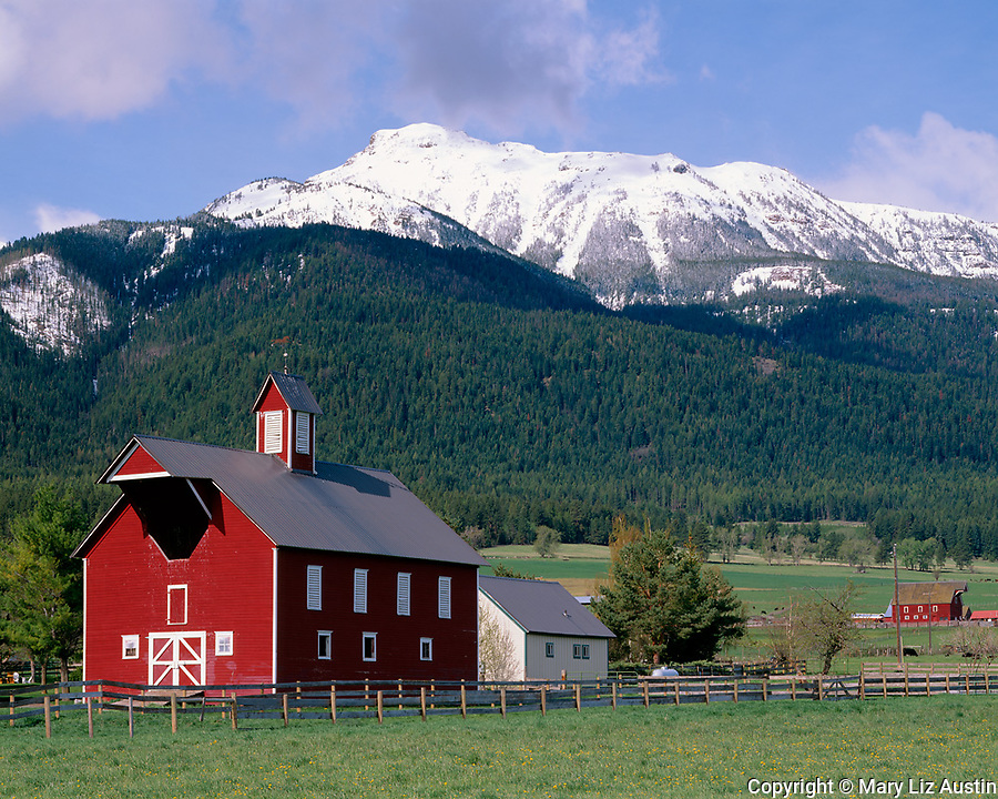 Wallowa County, OR   <br /> Red barn in the Alder Slope area of the Wallowa Valley under the Wallowa Mountains