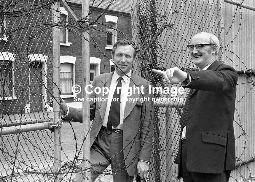 Two N Ireland Labour Party candidates, who could be seen as coming from different traditions, Paddy Doherty, and Billy Boyd, left, symbolically meet on the Peace Line in West Belfast. They are standing in the 1973 Assembly Election. 197306000384b.<br />