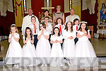 Ballylongford 1st Communion: Pupils from St Olivers NS, Ballylongford and Lenamore Ns who received their 1st communion in Ballylongford Church on Saturday last. Front ; Katie, Ruby, Deirbhile, Emilly, Eabha & Elisha. Centre : Calvin, Darragh, Martin & Gabriel. Back : Fr. P. Kennelly, M/s Anne Marie O'Keffe, Miss Margaret Maher & Fr. John Kennelly.