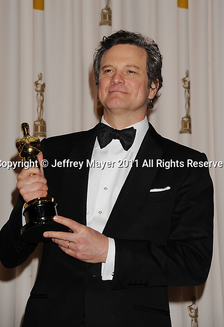 HOLLYWOOD, CA - FEBRUARY 27: Colin Firth poses in the press room during the 83rd Annual Academy Awards held at the Kodak Theatre on February 27, 2011 in Hollywood, California.