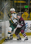 18 December 2016: Union College Dutchman Defenseman Ben Newhouse, a First Year from Edina, MN, checks University of Vermont Catamount Forward Liam Coughlin, a Sophomore from South Boston, MA, into the boards during the second period at Gutterson Fieldhouse in Burlington, Vermont. The Dutchmen defeated their former ECAC hockey rivals 2-1, sweeping their two-game weekend series. Mandatory Credit: Ed Wolfstein Photo *** RAW (NEF) Image File Available ***