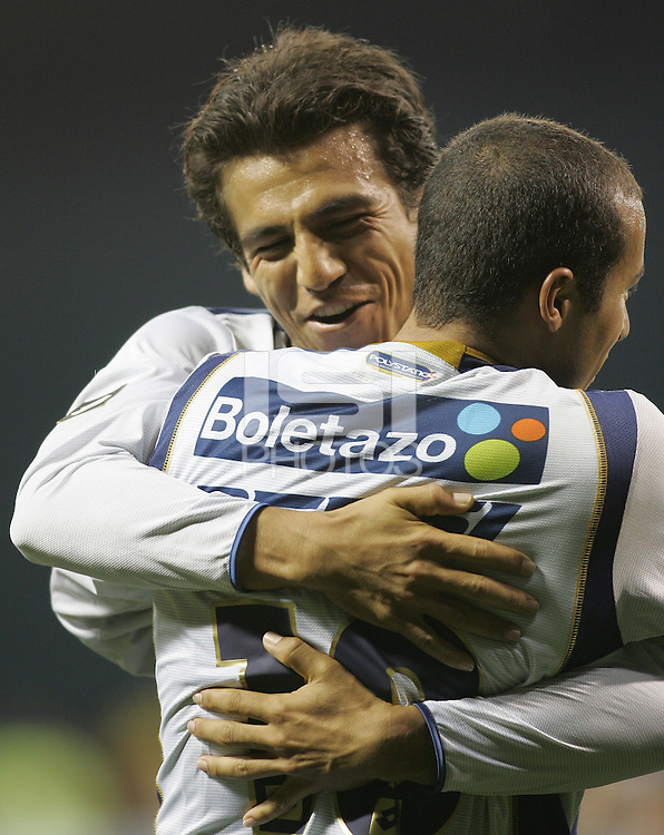 6 April 2005.  Pumas UNAM forward Ismael Iniguez (20, left) celebrates a goal with Ailton da Silva (10) during a CONCACAF Champion's Cup game  versus DC United at RFK Stadium in Washington, DC.