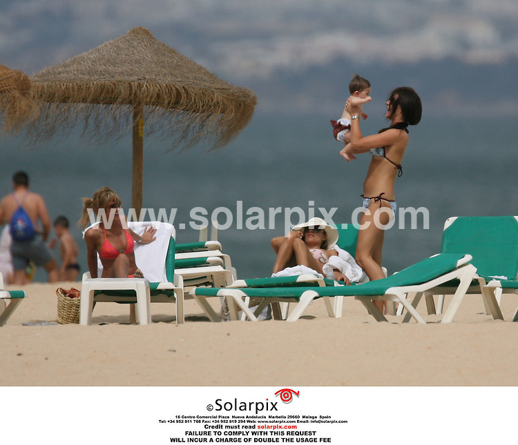 ALL ROUND PICTURES BY SOLARPIX.COM.MUST CREDIT SOLARPIX.COM OR DOUBLE FEE INCURRED.England Football Player Frank Lampard's  wife Elen Rives on the beach yesterday with their new baby :Elen leaves one of the girls holding her baby whilst on the pre World Cup break on the Algarve Portugal.Elen Rives passes her baby to a friend...JOB REF AB1- 19.5.06 2377