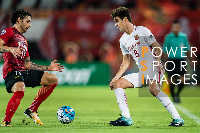 Guangzhou Forward Ricardo Goulart (L) in action against Shanghai FC Forward Oscar Emboaba Junior (R) during the AFC Champions League 2017 Quarter-Finals match between Guangzhou Evergrande (CHN) vs Shanghai SIPG (CHN) at the Tianhe Stadium on 12 September 2017 in Guangzhou, China. Photo by Marcio Rodrigo Machado / Power Sport Images