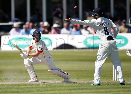 18.07.2016. Southport and Birkdale Cricket Club, Southport, England. Specsavers County Championship Cricket. Lancashire versus Durham. Lancashire wicket-keeper Tom Moores hits the ball past the outstretched hand of Durham fielder Jack Burnham.