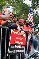 Verizon workers picket and protest  at Murry Bergtraum High School in New York City, New York on 17 August 2011, as the Department of Education's Panel for Education Policy votes on a $120 million two year contract with telecom giant Verizon to wire New York City schools.