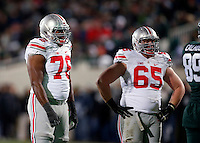 Ohio State Buckeyes offensive lineman Darryl Baldwin (76) and Ohio State Buckeyes offensive lineman Pat Elflein (65) against Michigan State Spartans at Spartan Stadium in East Lansing, Michigan on November 8, 2014.  (Dispatch photo by Kyle Robertson)