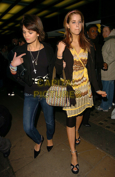 "PIXIE GELDOF & PEACHES GELDOF.""Derailed"" UK film premiere at Curzon Mayfair, London, UK..January 23rd, 2006.Ref: CAN.full length black jacket jeans dress yellow brown striped stripes sisters siblings family bag purse alice band tights leggings.www.capitalpictures.com.sales@capitalpictures.com.© Capital Pictures."