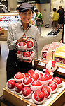 """September 28, 2016, Tokyo, Japan - Japan's Mitsukoshi department store sales clerk displays apples printed with Japan's famous kitten character Hello Kitty, produced in Aomori at the department store in Tokyo on Wednesday, September 28, 2016. Mitsukoshi started promotion of food products with Hello Kitty characters """"Hello Kitty Fair"""" at their food floor through October 11.   (Photo by Yoshio Tsunoda/AFLO) LWX -ytd-"""