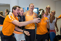 Bratislava, Slovenia, April 23, 2017,  FedCup: Slovakia-Netherlands, Dutch team celebrates in the dressing room, lor: Captain Paul Haarhuis, Richel Hogenkamp, Kiki Bertens, team docter Babette Pluim, Aranxa Rus and Cindy Burger  <br /> Photo: Tennisimages/Henk Koster