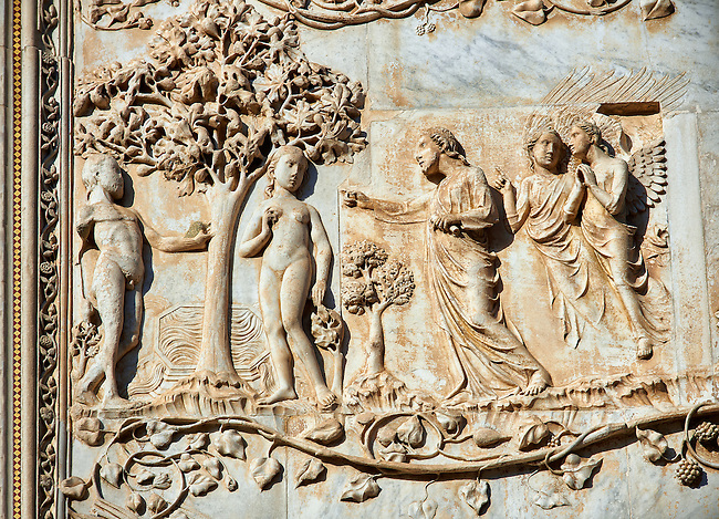 Bas-relief sculpture panel scene of Eve and Adam 's fall being discovered by Maitani around 1310 on the14th century Tuscan Gothic style facade of the Cathedral of Orvieto, Umbria, Italy