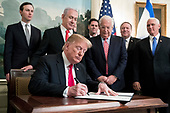 US President Donald J. Trump (C) signs an order recognizing Golan Heights as Israeli territory, in front of Prime Minister of Israel Benjamin Netanyahu (Back C), in the Diplomatic Reception Room of the White House in Washington, DC, USA, 25 March 2019. Also in the picture is Senior Advisor to the President Jared Kushner (Back L), US Ambassador to Israel David Friedman (3-R) and US Secretary of State Mike Pompeo (2-R) and US Vice President Mike Pence (R).<br /> Credit: Michael Reynolds / Pool via CNP