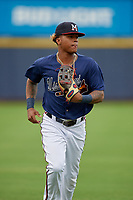 Mississippi Braves center fielder Cristian Pache (16) jogs to the dugout during a Southern League game against the Jacksonville Jumbo Shrimp on May 4, 2019 at Trustmark Park in Pearl, Mississippi.  Mississippi defeated Jacksonville 2-0.  (Mike Janes/Four Seam Images)