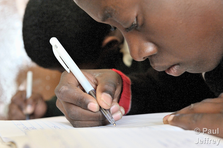 Children in a 7th grade class of the Isaacson Primary School in the Rockville area of Soweto, South Africa, write letters to the government's minister of health asking for easier access to medication for children who are living with HIV. The educational and advocacy work in this school is sponsored by the Christian AIDS Bureau for Southern Africa.