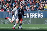 FOXBOROUGH, MA - MARCH 7: Djordje Mihailovic #14 of Chicago Fire passes the ball as Diego Fagundez #14 of New England Revolution pressures during a game between Chicago Fire and New England Revolution at Gillette Stadium on March 7, 2020 in Foxborough, Massachusetts.