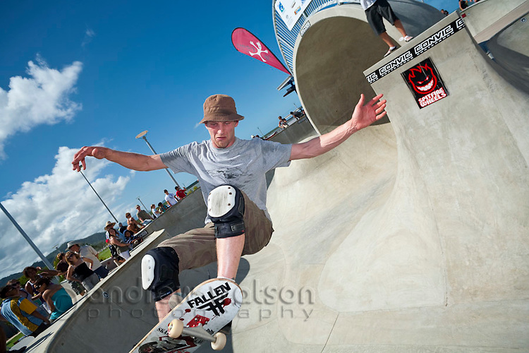 Skateboarder performing trick at skate park.  Cairns, Queensland, Australia