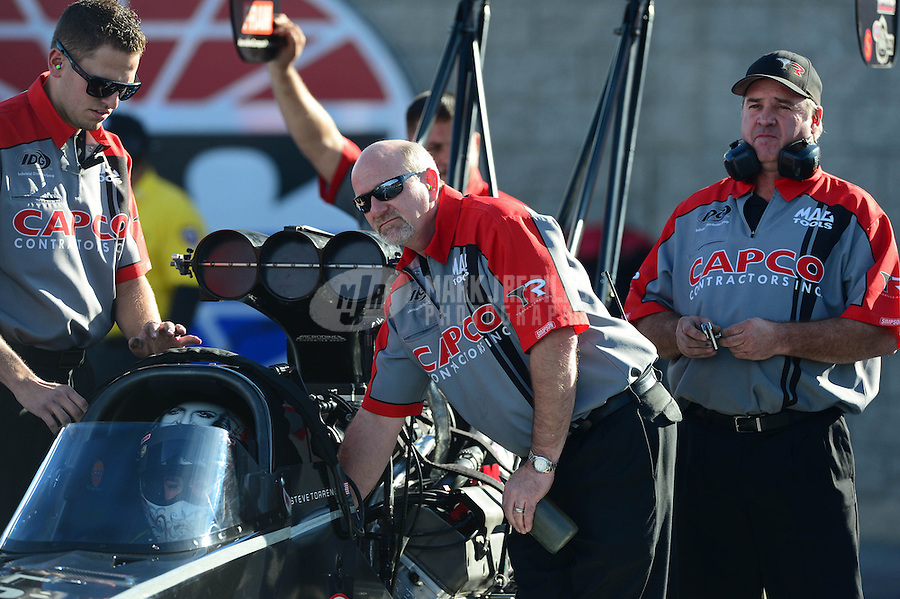Oct. 26, 2012; Las Vegas, NV, USA: Crew member for NHRA top fuel dragster driver Steve Torrence during qualifying for the Big O Tires Nationals at The Strip in Las Vegas. Mandatory Credit: Mark J. Rebilas-