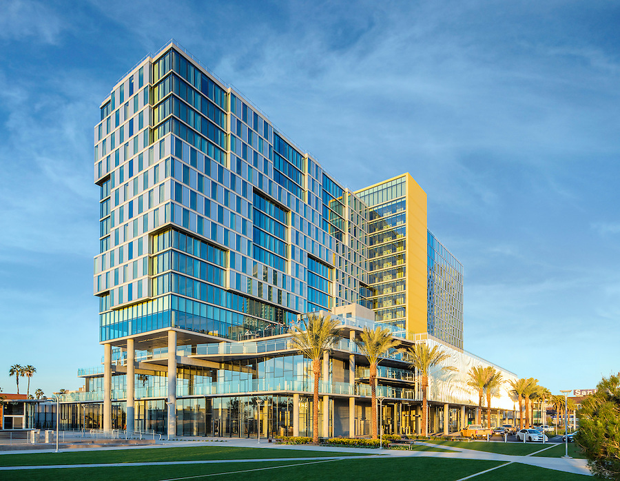 architects john portman & associates have designed a playful, rhythmic glass tower on what was once the pacific coast (baseball) league's lane field on the san diego bayfront