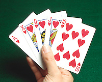 PLAYING CARDS: ROYAL FLUSH<br /> A straight flush (cards in sequential order under same suit) which is ace high.