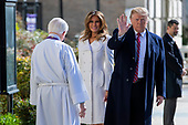 United States President Donald J. Trump (R) and First Lady Melania Trump (C) are greeted by Reverend W. Bruce McPherson (L) as they arrive to attend services at St. John's Episcopal Church in Washington, DC, USA, 17 March 2019. The Trumps are attending church on St. Patrick's Day.<br /> Credit: Erik S. Lesser / Pool via CNP