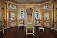 The Boudoir de la Reine or Silver Bedroom, designed by the architect Pierre-Marie Rousseau, 1751-1829, used by Marie-Antoinette, in the Queen's Apartments, Chateau de Fontainebleau, France. The paintings are by Michel-Hubert Bourgois and Jacques-Louis-Francois Touze and the mahogany parquet by Molitor, 1787. The Palace of Fontainebleau is one of the largest French royal palaces and was begun in the early 16th century for Francois I. It was listed as a UNESCO World Heritage Site in 1981. Picture by Manuel Cohen