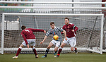 01.05.2018 Stenhousemuir v Queens Park: Aiden Kenna gets past Stenny defenders Ross Dunlop and Michael Dunlop