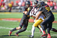 College Park, MD - OCT 15, 2016: Maryland Terrapins linebacker Shane Cockerille (2) and Maryland Terrapins defensive lineman Roman Braglio (90) tackle Minnesota Golden Gophers running back Shannon Brooks (23) for a loss during game between Maryland and Minnesota at Capital One Field at Maryland Stadium in College Park, MD. (Photo by Phil Peters/Media Images International)