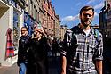 Edinburgh, UK. 15.04.2017. People walking up the Royal Mile, into the sunshine. Photograph © Jane Hobson.