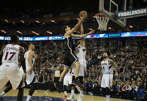 16.01.2014 London, England.  Brooklyn Nets' Forward Tornike Shengelia [20] in action during the NBA regular season game between the Atlanta Hawks and the Brooklyn Nets from the O2 Arena.