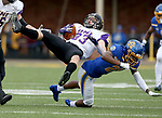 BROOKINGS, SD - NOVEMBER 16: Sam Schnee #23 of the Northern Iowa Panthers is brought down by Don Gardner #21 of the South Dakota State Jackrabbits during their game Saturday afternoon at Dana J. Dykhouse Stadium in Brookings, SD. (Photo by Dave Eggen/Inertia)