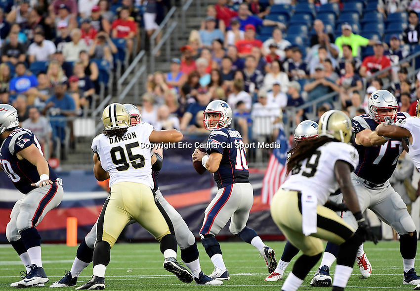 Thursday August 11, 2016: New England Patriots quarterback Jimmy Garoppolo (10) looks for a receiver during an NFL pre-season game between the New Orleans Saints and the New England Patriots held at Gillette Stadium in Foxborough Massachusetts. The Patriots defeat the Saints 34-22 in regulation time. Eric Canha/CSM