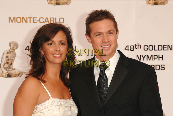 KERI CLOSE & ERIC CLOSE.At the Golden Nymph awards ceremony during the 2008 Monte Carlo Television Festival held at Grimaldi Forum, Monte Carlo, Principality of Monaco, .June 12, 2008..portrait headshot tie white cream suit.CAP/TTL .©TTL/Capital Pictures