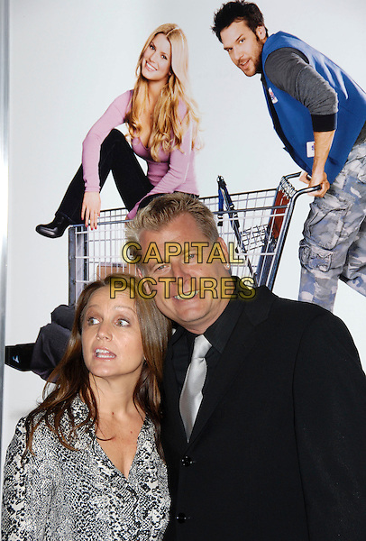 """TINA SIMPSON & JOE SIMPSON.The Lions Gate Premiere of """"Employee of the Month"""" held at The Grauman's Chinese Theatre in Hollywood, California, USA. .September 19th, 2006.Ref: DVS.headshot portrait.www.capitalpictures.com.sales@capitalpictures.com.©Debbie VanStory/Capital Pictures"""