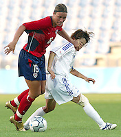 20 August 2004:   Abby Wambach in action against Japan during the quarterfinals at Kaftanzoglio Stadium in Thessaloniki, Greece.     USA defeated Japan, 2-1 .   Credit: Michael Pimentel / ISI