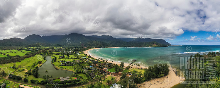 An aerial view of Hanalei Bay, Beach and Pier plus the surrounding area in Kaua'i.