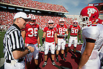 Wisconsin Badgers captains Mickey Turner (36), Chris Maragos (21, Garrett Graham (89) and O'Brien Schofield (50) meet at midfield for the coin toss against the Fresno State Bulldogs during an NCAA college football game on September 12, 2009 at Camp Randall Stadium in Madison, Wisconsin. The Badgers won in double overtime 34-31. (Photo by David Stluka)