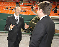 MLS head Don Garber chats with MC Dave Johnson during festivities surrounding the final appearance of Jaime Moreno in a D.C. United uniform, at RFK Stadium, in Washington D.C. on October 23, 2010. Toronto won 3-2.