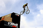 June 7, 2009:  An airborne cyclist goes off the jump in the Slopestyle competition during the Teva Mountain Games, Vail, Colorado.