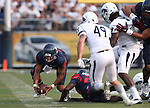 Arizona quarterback Anu Solomon picks up a loose ball under pressure from Nevada defenders Jordan Dobrich (49) and Lenny Jones (94) in an NCAA college football game in Reno, Nev., on Saturday, Sept. 12, 2015.(AP Photo/Cathleen Allison)